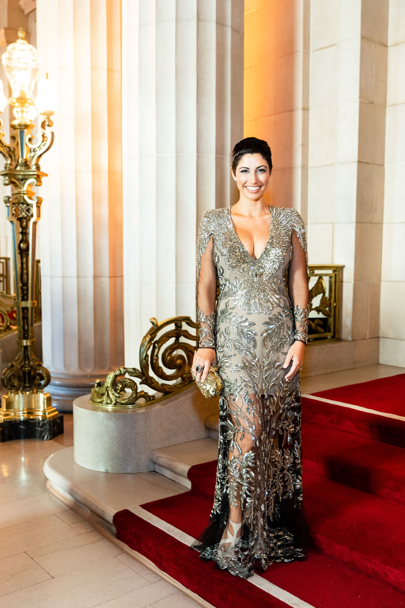Chrisa Pappas goes to the Opera wearing a champagne gold sequin Alexander McQueen dress completed with an Alexander McQueen clutch to match.