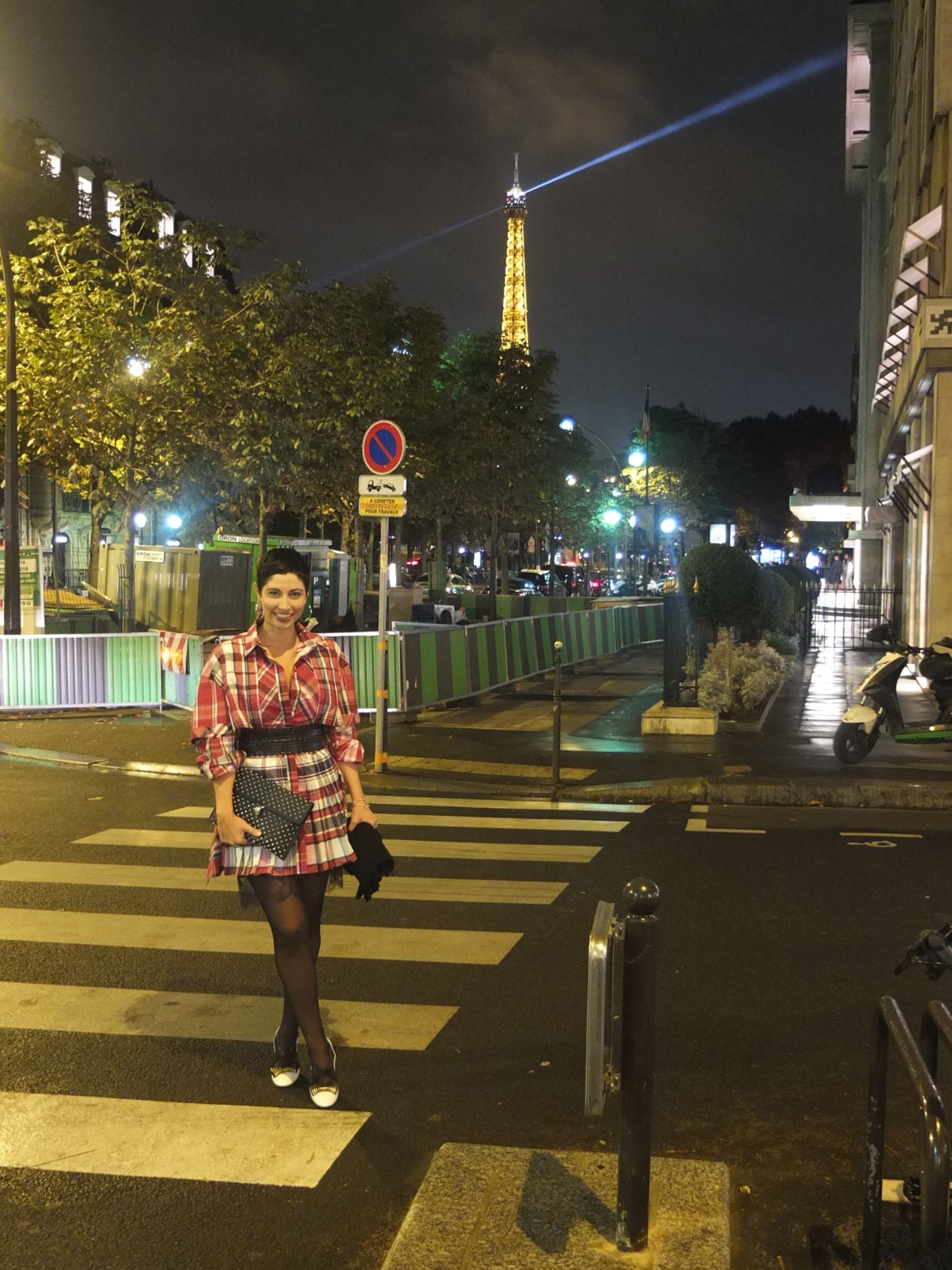 Chrisa Pappas in a pleated check Alexander McQueen mini dress out for a night on the town in Paris.