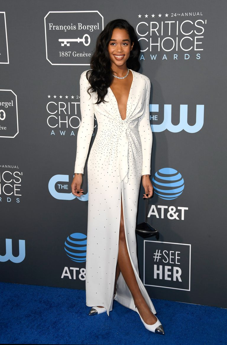 Laura Harrier wore a white, diamond-studded Louis Vuitton dress and is accessorized with Bulgari jewelry at the 24th Annual Critics' Choice Awards.